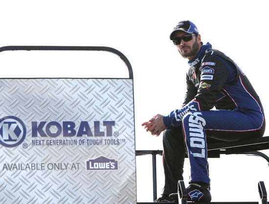 Jimmie Johnson takes in NASCAR Sprint Cup Series practice from a hauler-top vantage point at Homestead-Miami Speedway on Saturday, Nov. 19.(Credit: By Jerry Markland, Getty Images for NASCAR)