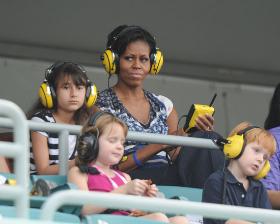 Michelle Obama watches the Ford 400 action at Homestead-Miami Speedway after meeting with families of soliders for Joining Forces. (Credit: Larry Marano/Getty Images)