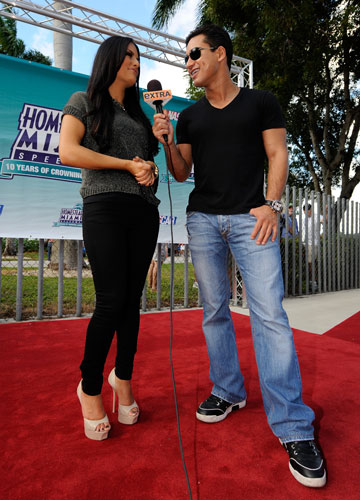 TV personality Mario Lopez interviews singer Pia Toscana on the red carpet at Homestead-Miami Speedway on Sunday, Nov. 20. Toscano sang the National Anthem before the season-ending Ford 400. (Credit: By Jared C. Tilton, Getty Images)
