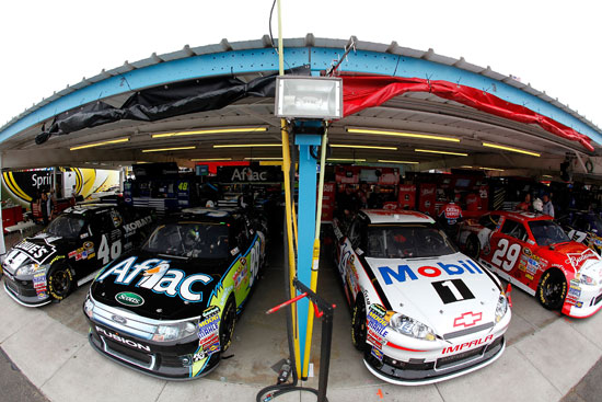 (Left to right) The cars of Chase for the NASCAR Sprint Cup contenders Jimmie Johnson, Carl Edwards, Tony Stewart and Kevin Harvick are parked in the garage next to each other during practice for the NASCAR Sprint Cup Series Kobalt Tools 500 at Phoenix International Raceway on Friday in Avondale, Ariz. (Credit: Jonathan Ferrey/Getty Images)