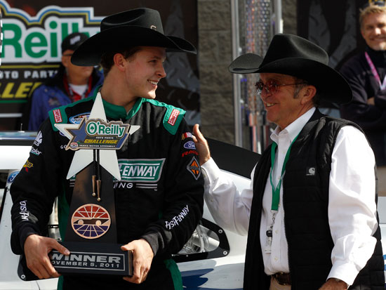 Team owner Jack Roush (right) congratulates Trevor Bayne, driver of the #16 RickyVsTrevor.com Ford, in Victory Lane after his win at the NASCAR Nationwide Series O'Reilly Auto Parts Challenge at Texas Motor Speedway on Nov. 5, 2011, in Fort Worth, Texas. (Credit: Chris Graythen/Getty Images)