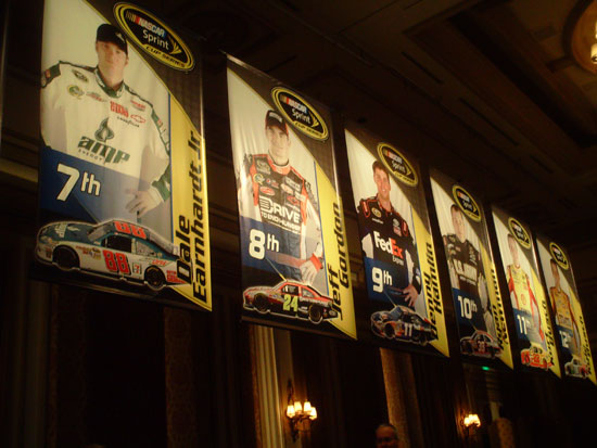 Banners for the top-12 drivers lined the walls of the Bellagio ballroom