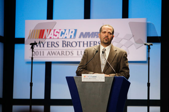 Darian Grubb, winner of the Champions Crew Chief Award, speaks during the NASCAR Sprint Cup Series Champion's Week NMPA Myers Brothers Awards Luncheon at the Bellagio on Dec. 1, 2011, in Las Vegas, Nev. (Credit: Todd Warshaw/Getty Images for NASCAR)