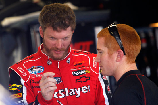 Dale Earnhardt Jr. passes on restrictor plate wisdom to his new driver, Cole Whitt. (Credit: Todd Warshaw/Getty Images for NASCAR)
