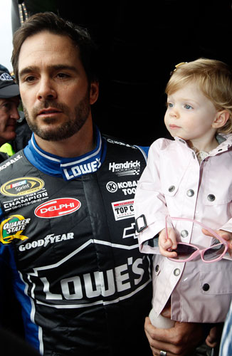 Five-time NASCAR Sprint Cup Series champion Jimmie Johnson holds daughter Genevieve Marie before driver introductions on Sunday at Daytona International Speedway in Daytona Beach, Fla. (Credit: Streeter Lecka/Getty Images)