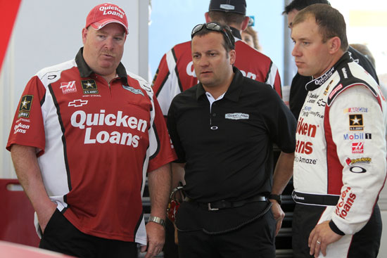 (Right to left) Ryan Newman, Stewart-Haas Racing competition director Greg Zipadelli and No. 39 crew chief Tony Gibson talk during NASCAR Sprint Cup Series practice on Saturday at Las Vegas Motor Speedway in Las Vegas, Nev. (Credit: Jerry Markland/Getty Images for NASCAR)