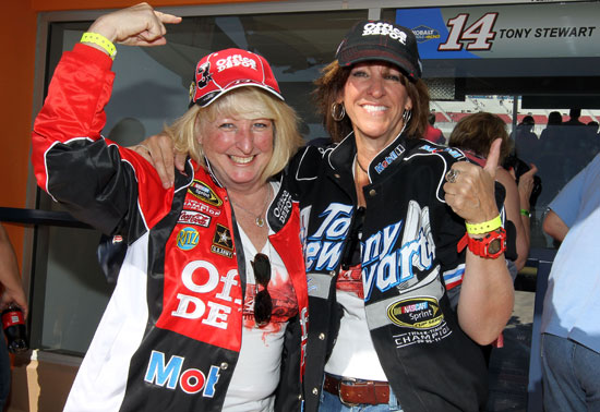 Two Tony Stewart fans are happy the three-time and defending champion turned the third-fastest lap in practice Friday at Las Vegas Motor Speedway in Las Vegas, Nev. (Credit: Jeff Bottari/Getty Images for NASCAR)