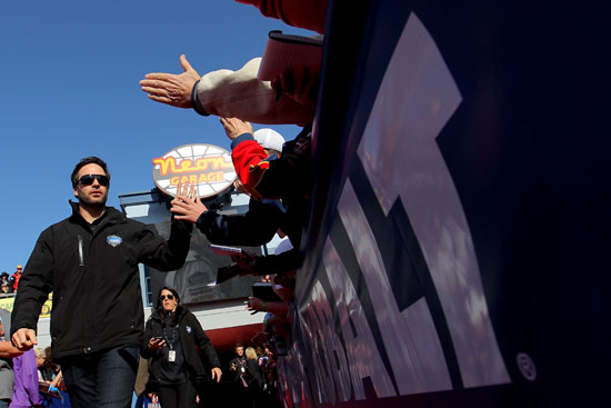 Four-time Las Vegas Motor Speedway race winner Jimmie Johnson greets fans on the way to the drivers' meeting in the Neon Garage at the track before the NASCAR Sprint Cup Series Kobalt Tools 400 on Sunday at Las Vegas Motor Speedway in Las Vegas, Nev. (Credit: Justin Edmonds/Getty Images for NASCAR)
