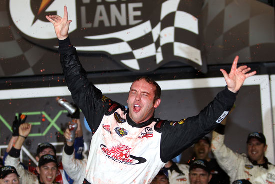 John King, driver of the #7 Red Horse Racing Toyota, celebrates in Victory Lane after winning the NASCAR Camping World Truck Series NextEra Energy Resources 250 at Daytona International Speedway on February 24, 2012 in Daytona Beach, Florida. (Photo by Jerry Markland/Getty Images for NASCAR)