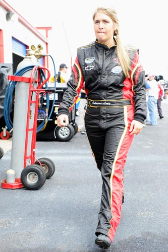 Johanna Long walks through the garage prior to practice for the Aaron's 312 at her home track, Talladega Superspeedway. (Credit: John Harrelson/Getty Images for NASCAR)
