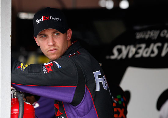 Denny Hamlin, driver of the #11 FedEx Autism Speaks Toyota, stands in the garage area during practice for the NASCAR Sprint Cup Series FedEx 400 benefiting Autism Speaks at Dover International Speedway on June 1, 2012 in Dover, Delaware. (Photo by Rob Carr/Getty Images for NASCAR)