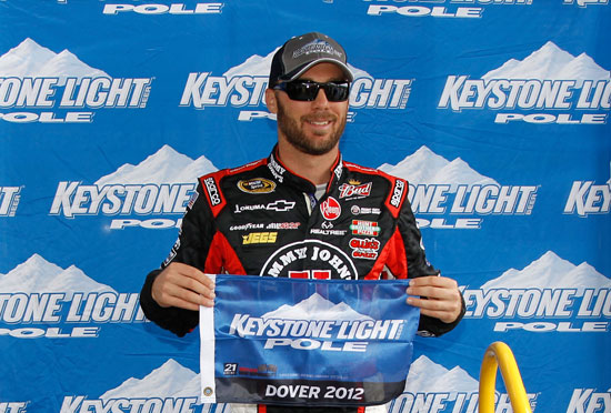 Kevin Harvick, driver of the #2 Tide Chevrolet, poses with the Keystone Light Pole award after qualifying for the pole position for the NASCAR Camping World Truck Series Lucas Oil 200 at Dover International Speedway on June 1, 2012 in Dover, Delaware. (Photo by Todd Warshaw/Getty Images)