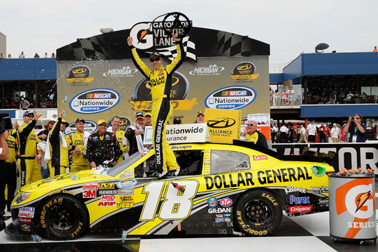 Joey Logano, driver of the No. 18 Dollar General Toyota, celebrate sin Victory Lane after winning the NASCAR Nationwide Series Alliance Truck Parts 250 at Michigan International Speedway on Saturday in Brooklyn, Mich. (Credit: John Harrelson/Getty Images for NASCAR)