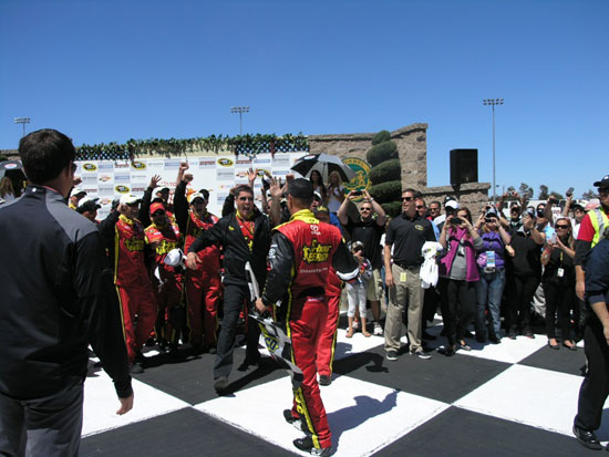 Clint Bowyer's crew greets him (happily) in victory lane at Sonoma last month. Credit: Keri Luiz