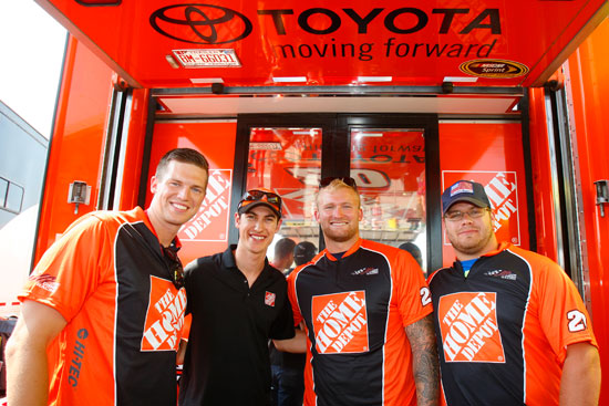L-R New England Patriots Zoltan Mesko, punter, Nick McDonald, offensive lineman, and Ryan Wendell, center, meet with Joey Logano at New Hampshire Motor Speedway. (Credit: Toyota Racing)