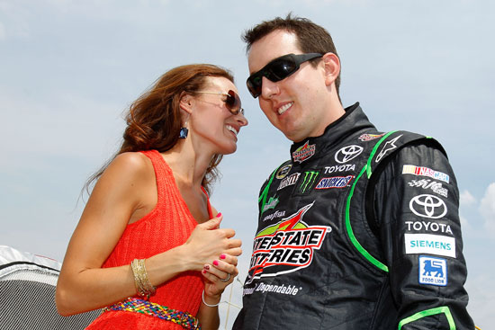 Polesitter Kyle Busch laughs with wife Samantha before the LENOX Industrial Tools 301 at New Hampshire Motor Speedway. (Credit: Todd Warshaw/Getty Images for NASCAR)