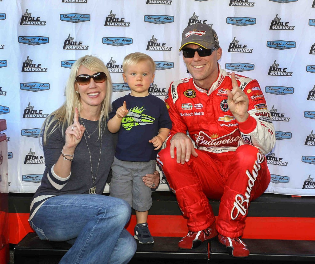 Kevin Harvick, driver of the #4 Budweiser Chevrolet SS captured the pole position Friday, September 26, 2014 for Sunday's Chase Challenger 16 NASCAR Sprint Cup race at Dover International Speedway in Dover, Delaware. With him are his wife, DeLana and son, Keelan. Harvick is in the Chase. Sunday will determine who advances to the next phase of the Chase, the Contender 12.  (Photo by Christa L Thomas/HHP for Chevy Racing)