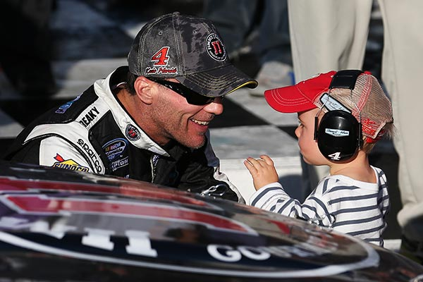 Kevin Harvick, driver of the #5 Jimmy John's Chevrolet, celebrates with his son, Keelan, in victory lane after winning the NASCAR Nationwide Series Jimmy John's Freaky Fast 300 at Chicagoland Speedway on September 13, 2014 in Joliet, Illinois. (Credit: Nick Laham/Getty Images)